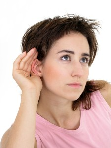 bigstockphoto_Woman_With_Hand_To_Ear_Listeni_209983